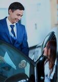 Woman buying a new car. Woman buying a new car Royalty Free Stock Photos