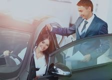 Business woman chooses a car in the office Royalty Free Stock Photos