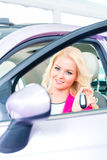 Woman buying new car at dealership Stock Photos