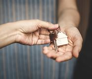 Woman buying a new house. And getting the new key Royalty Free Stock Photos