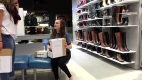 Woman buying new shoes. Inside Spring shoes store stock video