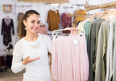 Woman buying new skirt at the store Stock Photography