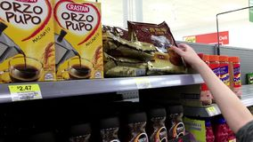 Woman buying old town white coffee. Inside Walmart store stock footage