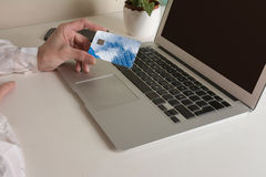 Woman buying online with credit card. Royalty Free Stock Photography