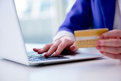 The woman buying online with credit plastic card Royalty Free Stock Image