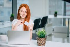 Free Woman Buying Online With Laptot And Looking At Credit Card Stock Images - 106584624
