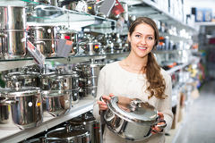Woman buying pan in shop Royalty Free Stock Images