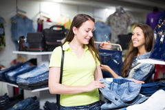 Woman buying pants in store Royalty Free Stock Photography