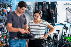 Woman buying parts in bike shop Royalty Free Stock Photos