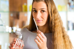 Woman buying perfume in shop or store Royalty Free Stock Images