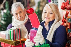 Woman Buying Presents With Man In Store Royalty Free Stock Image