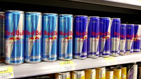 Woman buying Red Bull sugarfree energy drink Royalty Free Stock Photo