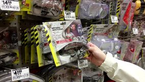 Woman buying safety glasses stock footage