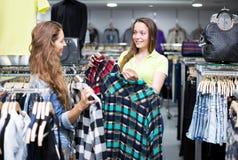 Woman buying shirt Royalty Free Stock Photo