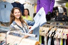 Woman buying shirt Stock Photo