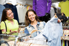 Woman buying shirt Royalty Free Stock Image