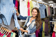 Woman buying shirt Stock Images