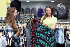 Woman buying shirt Stock Photography