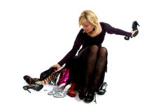 Woman buying shoes Royalty Free Stock Photos