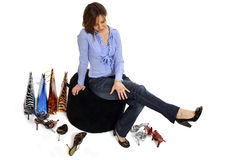 Woman buying shoes Stock Image