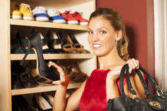 Woman buying shoes. Happy young Woman buying shoes Stock Photography