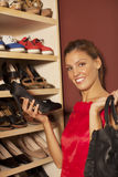 Woman buying shoes. Happy young woman buying shoes Stock Photos