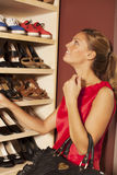 Woman buying shoes Stock Images