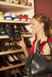 Woman buying shoes Stock Photos