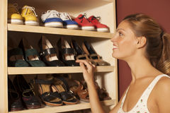 Woman buying shoes. Happy young woman choosing shoes Stock Photos