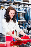 Woman buying shoes in shop Royalty Free Stock Photography