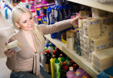 Woman buying soap in the shop. Woman buying soap for house in the shopping mall Royalty Free Stock Images