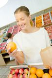 Woman buying some oranges. Agriculture royalty free stock photos