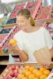 Woman buying some oranges. Agriculture royalty free stock photography