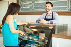Woman buying some pastries Royalty Free Stock Photos