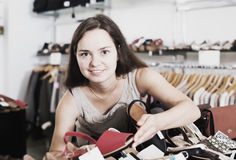 Woman buying summer shoes Royalty Free Stock Photography