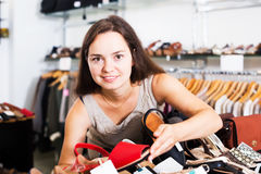 Woman buying summer shoes Royalty Free Stock Photos