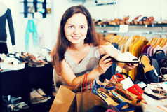 Woman buying summer shoes Stock Photos