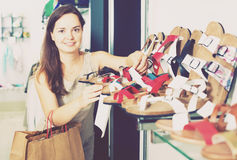 Woman buying summer shoes Royalty Free Stock Image