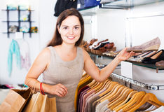 Woman buying summer shoes Royalty Free Stock Photo