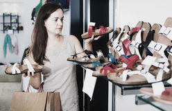 Woman buying summer shoes Stock Photography