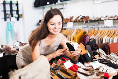 Woman buying summer shoes Stock Photo