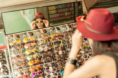 Woman buying sunglasses Stock Images