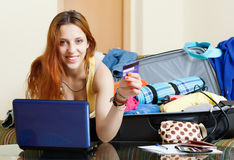 Woman buying tickets  online in  internet Royalty Free Stock Photography
