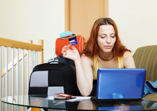 Woman buying tickets or reserving resort online Stock Photo