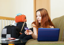 Woman buying tickets or reserving resort online Stock Photography