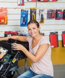 Woman Buying Tools In Hardware Store Royalty Free Stock Image