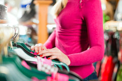 Woman is buying Tracht or dirndl in a shop Stock Photography