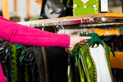 Woman is buying Tracht or dirndl in a shop Royalty Free Stock Image
