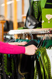 Woman is buying Tracht or dirndl in a shop Royalty Free Stock Photos