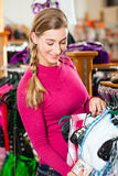 Woman is buying Tracht or dirndl in a shop Royalty Free Stock Images